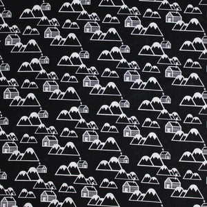 Square swatch of mountain cabins printed fabric in black (black fabric with tossed white cartoon mountains and cabin print repeated)