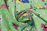 Swirled swatch mae flowers scene (girls with umbrellas) printed fabric in green
