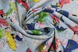 Swirled swatch mae flowers scene (girls with umbrellas) printed fabric in blue