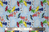 Flat swatch mae flowers scene (girls with umbrellas) printed fabric in blue
