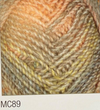 Swatch of Marble Chunky yarn in shade MC89 (tan, yellow, orange, beige faded shades with twists)