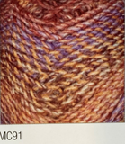 Swatch of Marble Chunky yarn in shade MC91 (orange and brown, purple and orange shades with twists)