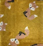Swatch of two-sided fleece flannel in Fox (light brown foxes on gold)