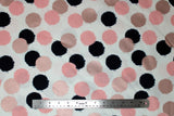 Flat swatch circles & dots print fabric in blush (pink/black circles on white)