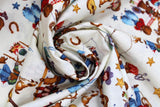Swirled swatch rodeo kids (on white) cartoon printed fabric