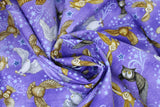 Swirled swatch animal themed printed fabric in Owls (on purple)