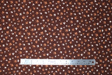 Flat swatch animal themed printed fabric in Paws on Brown