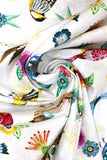 Swirled swatch animal themed printed fabric in Floral Flight White