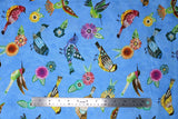 Flat swatch animal themed printed fabric in Floral Flight Blue