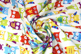Swirled swatch animal themed printed fabric in Petite Elin (multicoloured owls)