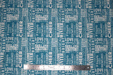 Flat swatch winter printed fabric in Text on Blue (winter words)
