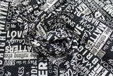 Swirled swatch winter printed fabric in Text on Black (winter words)