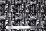 Flat swatch winter printed fabric in Text on Black (winter words)