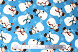 Flat swatch winter printed fabric in Snowmen on Blue