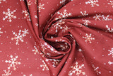 Swirled swatch winter printed fabric in White Snowflakes on Burgundy