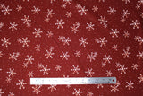 Flat swatch winter printed fabric in White Snowflakes on Burgundy