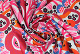 Swirled swatch summer themed fabric in Colourful Flowers (red/orange)