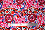 Flat swatch summer themed fabric in Colourful Flowers (red/orange)