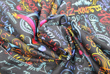Swirled swatch multi-coloured religious text on black print fabric