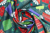 Swirled swatch Christmas printed fabric in Presents on Dark Green