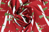 Swirled swatch Christmas printed fabric in Snowy Trees on Red