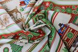 Swirled swatch Christmas printed fabric in Cartoon Christmas Stripes on White