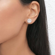 Close up of woman wearing a silver cubic zirconia 10mm stud circle round earring.