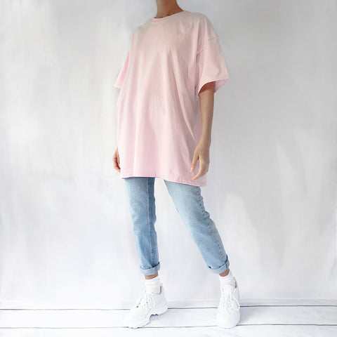 Light pink oversized plain t-shirt dress for women paired with mom jeans and chunky trainers. Ethically made t-shirt.