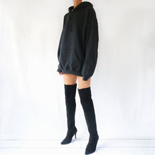Black oversized plain hoodie dress for women paired with knee high boots. Available in size S,M,L.