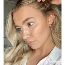 Influencer Emily Simmons wearing thick small gold hoops with 2 cubic zirconia stars-Rani & Co.