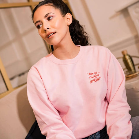 Slogan pink sweatshirt with red embroidered 'Does my sassiness upset you?' quote from Maya Angelou Still I Rise poem