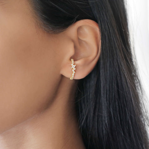 Gold ear cuff earring with cubic zirconia stones wraps around ear lobe, dainty jewellery by Rani & Co.