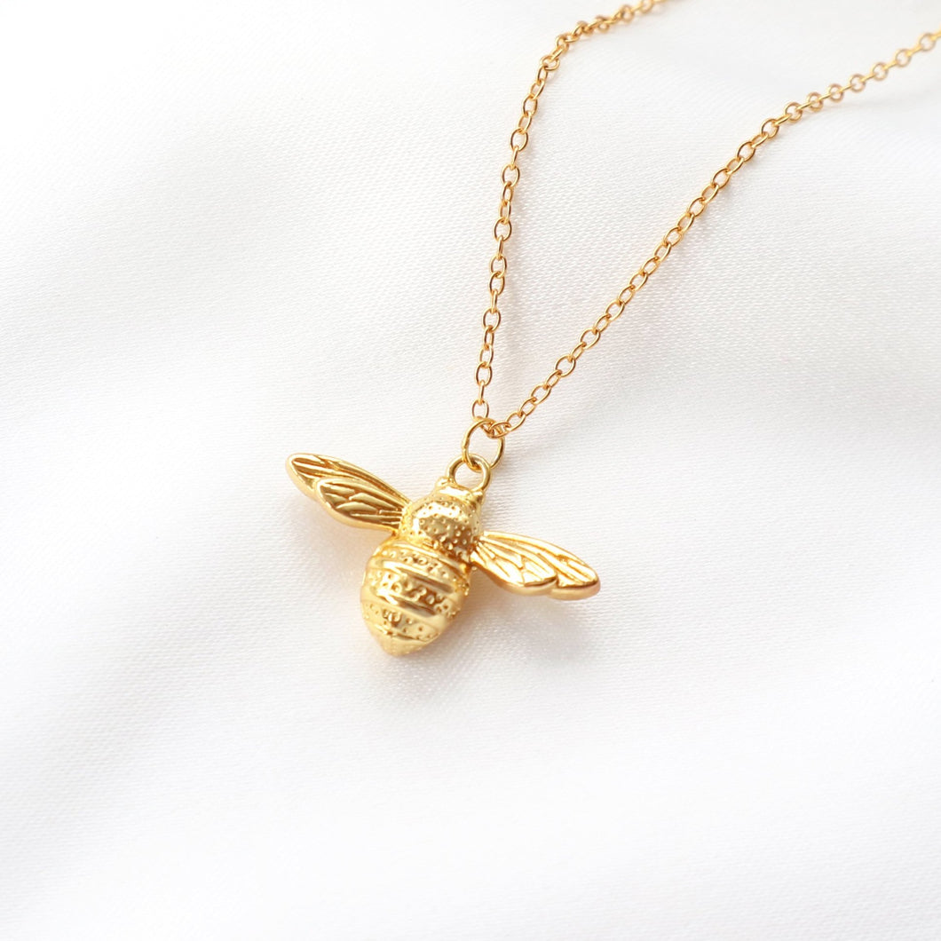 Gold Queen Bumble bee pendant necklace, dainty animal necklace. Rani & Co. jewellery