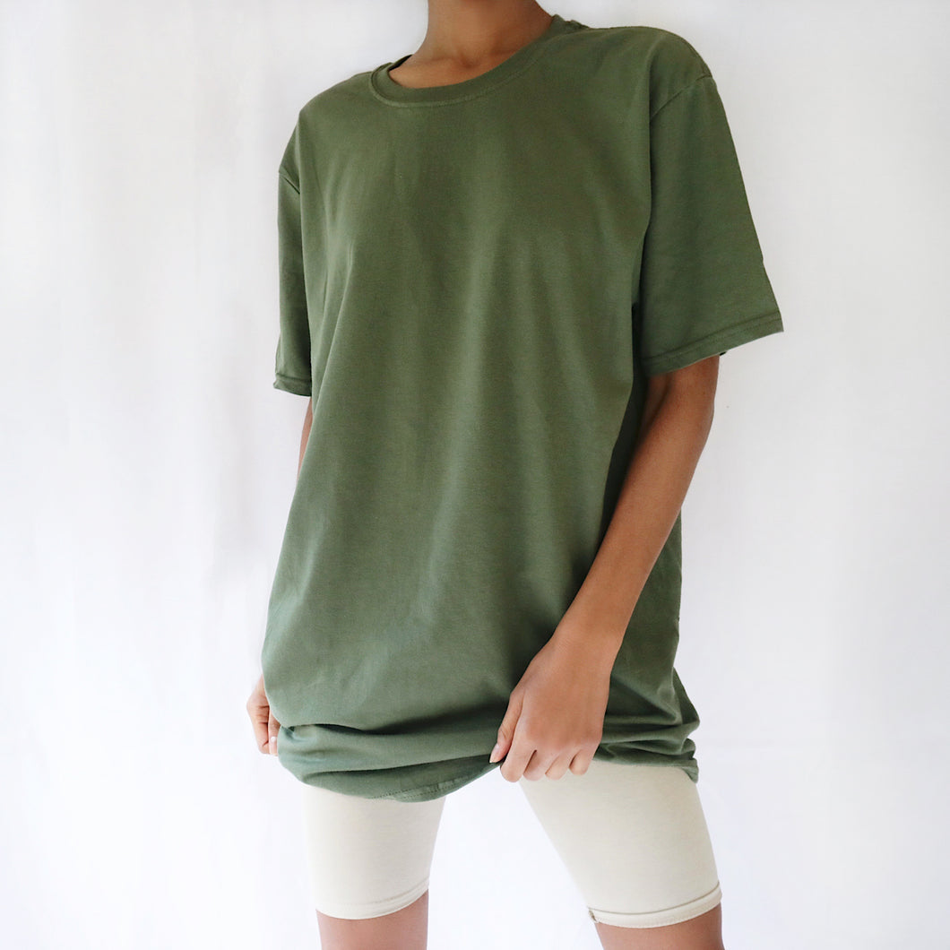 Khaki green oversized plain t-shirt dress for women paired with cream cycling shorts. Ethical vegan t-shirt.