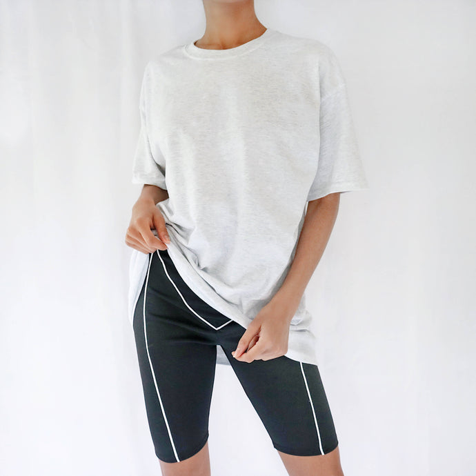 Grey oversized plain t-shirt dress for women paired with black cycling shorts. Ethical t-shirt.