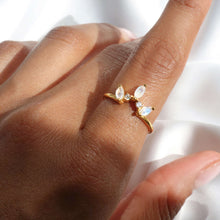 Moonstone crown ring with 2 cubic zirconia stones & 18k gold-plated band.
