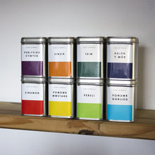 Four Storage Tins