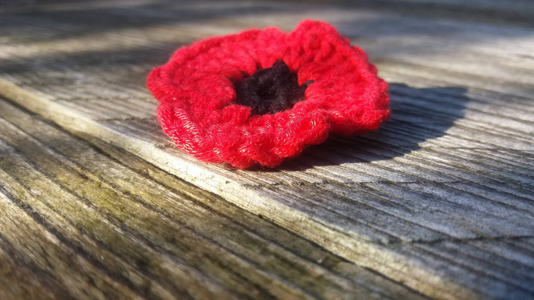 Hand crocheted red poppy brooch with one pound donation to British Legion