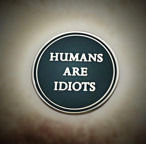 Humans Are Idiots Black and Silver Round Metal Pin