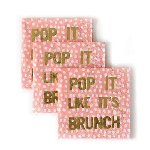 peach colored party napkins with gold text that reads pop it like its brunch