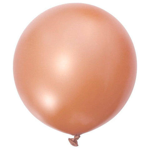 large rose gold balloon filled with helium against white background