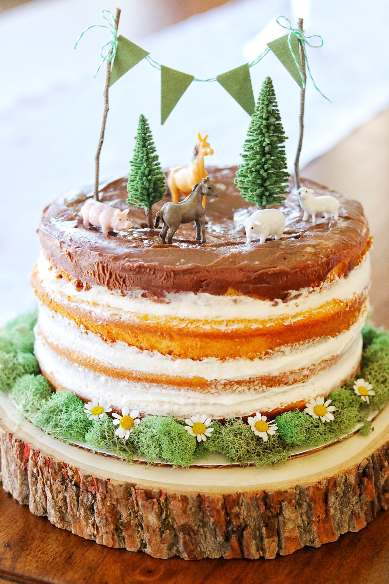 3 tiered cake topped with farm animals