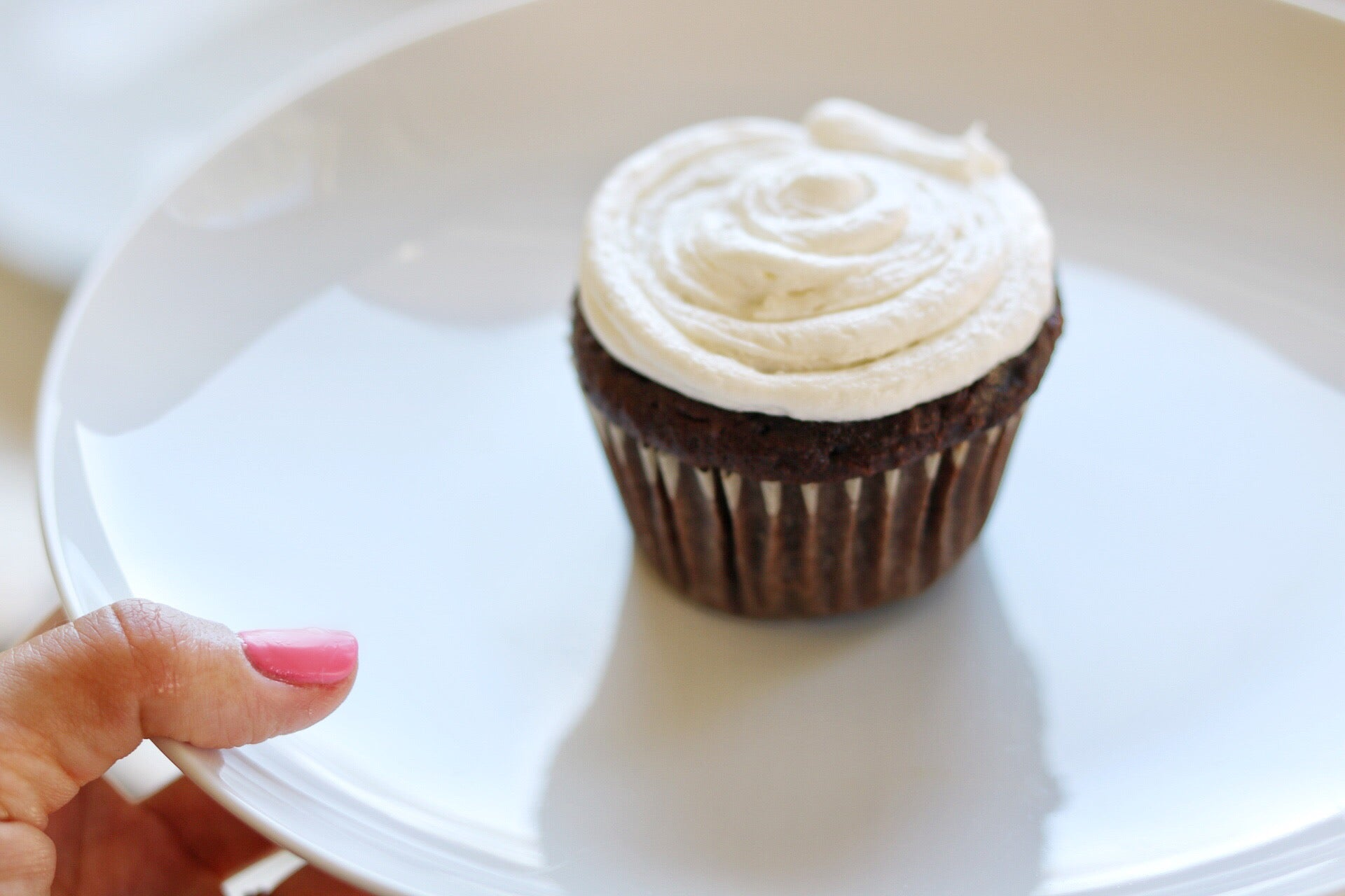 freshly baked chocolate cupcake with marshmallow frosting