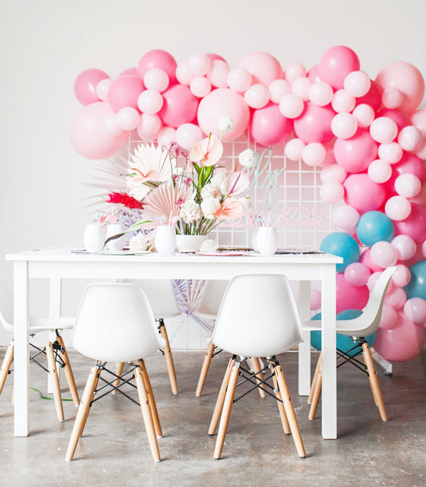 valentines day party setup with pink balloons