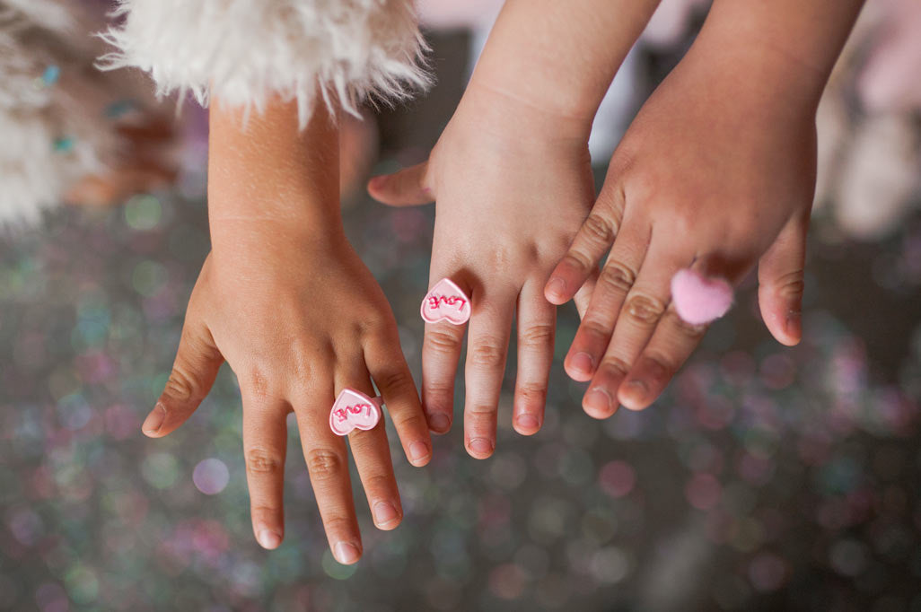 little girls wearing Valentine's heart rings