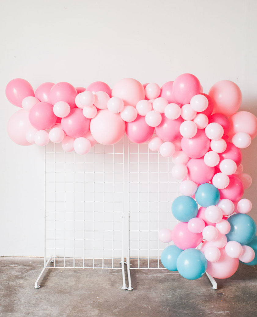 pink balloon garland against wall