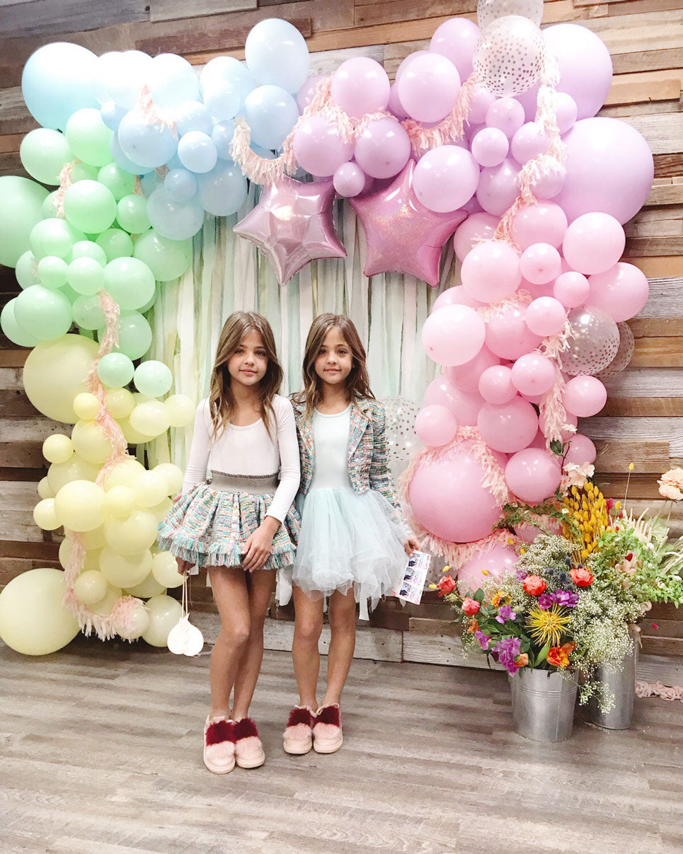 pretty pastel balloons with two girls smiling