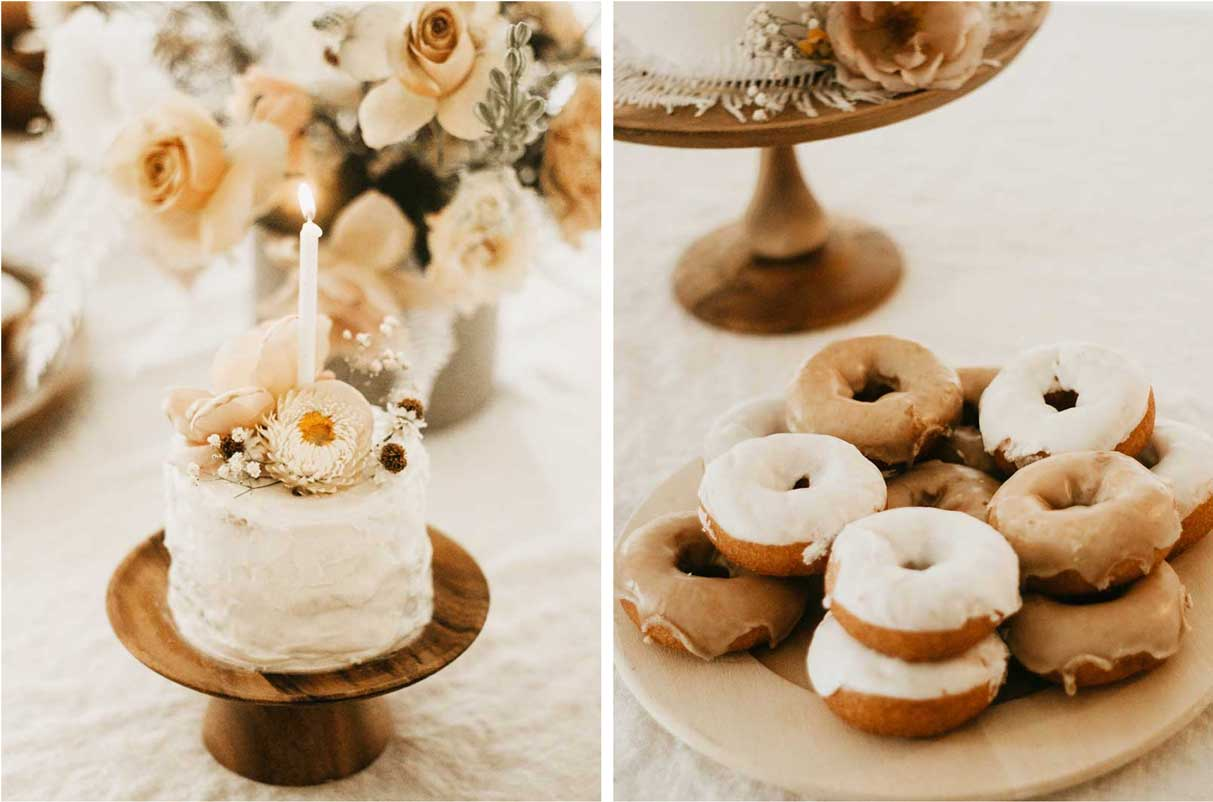 mini cake with a candle lit and a plate of donuts