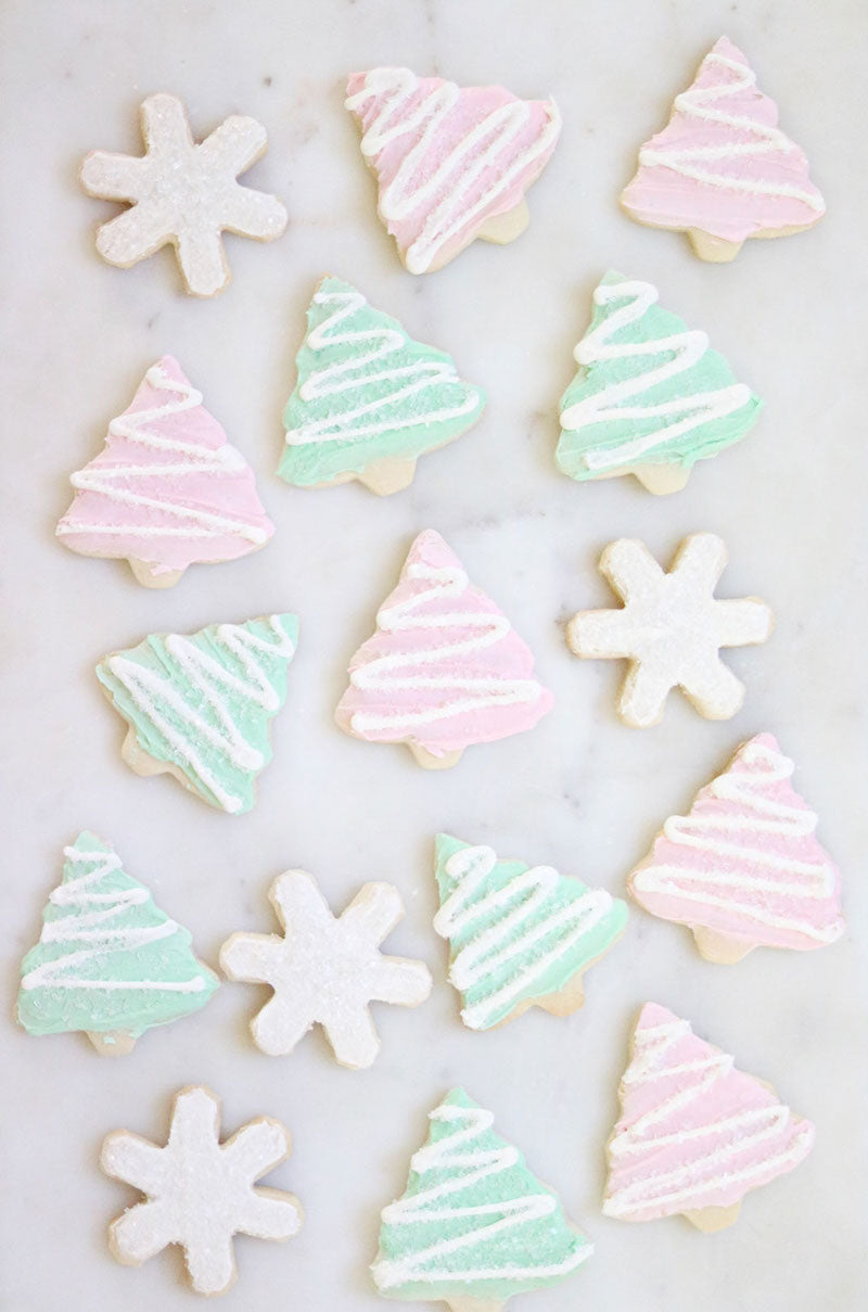 christmas tree sugar cookies frosted with pink and green frosting