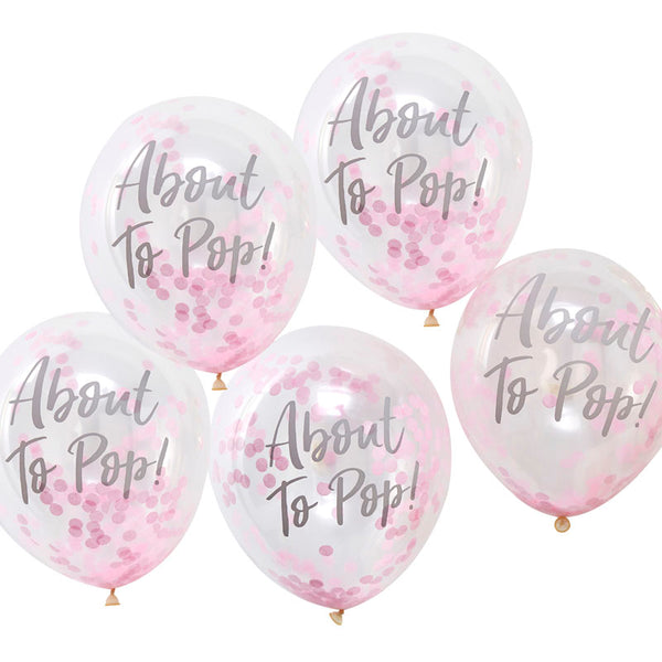 pink about to pop balloons